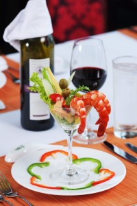 serving wine with sea food on cruise