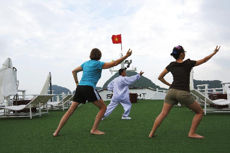 Tai Chi exercise on starlight halong bay Cruises