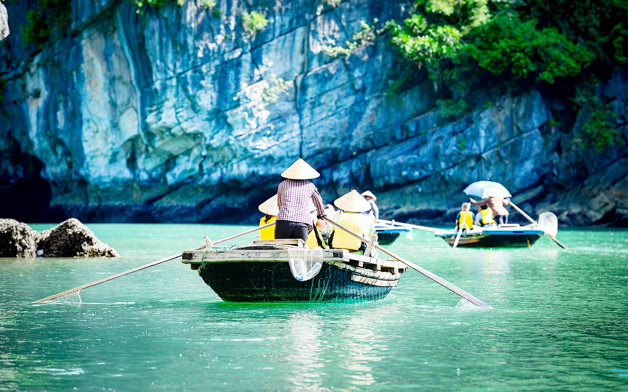 Bamboo Rowing Boat in Halong Bay cruise tour